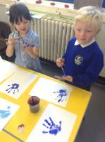Year 1 made a rainbow from painted handprints